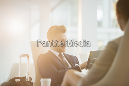 business people working in airport