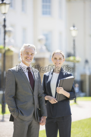 business people smiling on city street