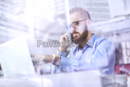 businessman talking on cell phone and