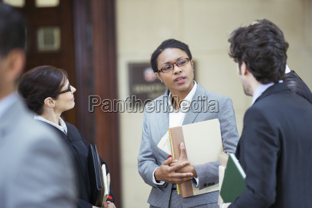 lawyers talking outside courtroom