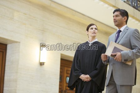 judge and lawyer talking in courthouse