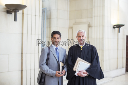 judge and lawyer together in courthouse