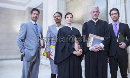 judges and lawyers standing together in
