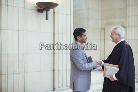 judge and lawyer shaking hands in