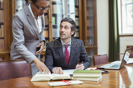 lawyers doing research together in chambers