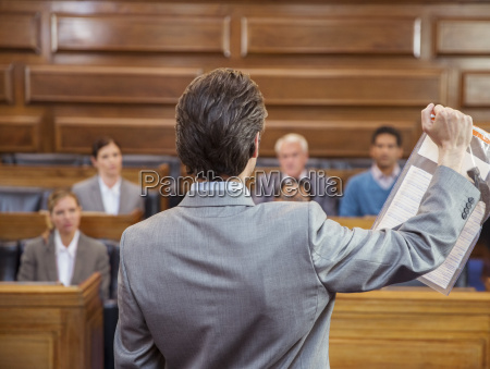lawyer showing documents to jury in