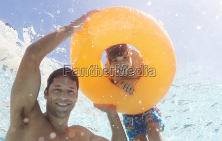 father and son playing in swimming