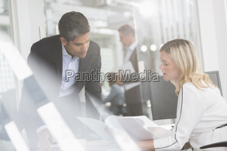 business people reviewing paperwork in conference