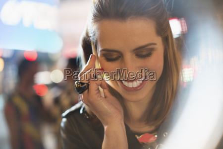 woman taking on cell phone on