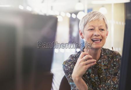 senior businesswoman working at computer in