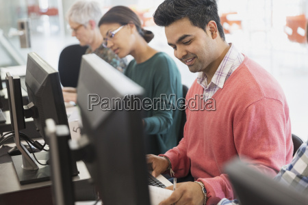 smiling adult education student at computer