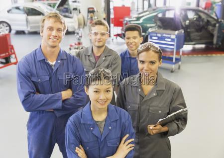 portrait confident mechanics in auto repair