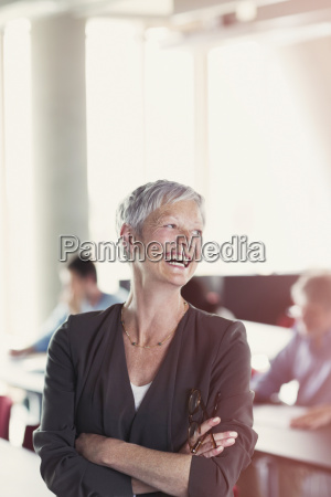 laughing senior woman in adult education