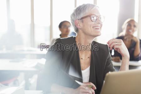 smiling senior woman at laptop in
