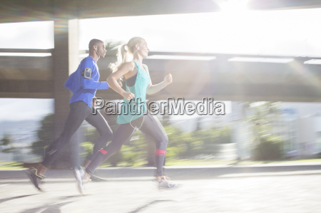 couple running through city streets together