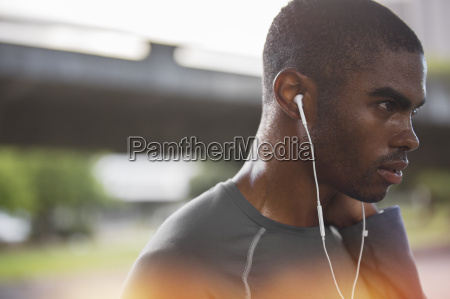 man resting after exercising on city