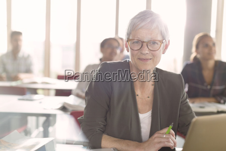 portrait smiling senior woman at laptop