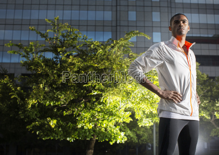 man standing in urban park at