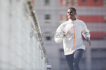 man running through city streets