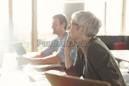 attentive senior woman listening in adult