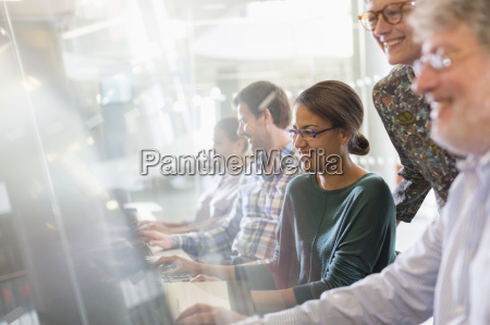 students at computers in adult education