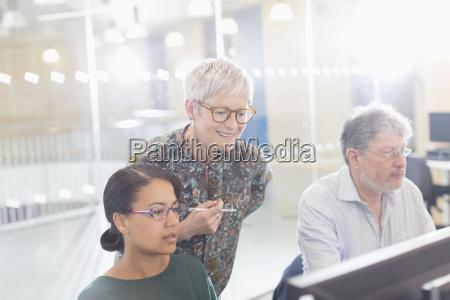 businesswomen working at computer in office