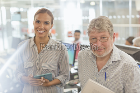 portrait confident business people in office