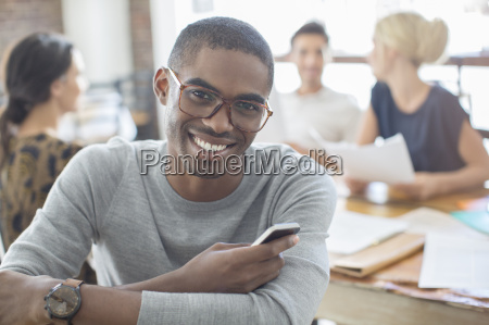 businessman using cell phone at meeting