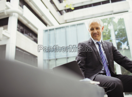 businessman using laptop in office building