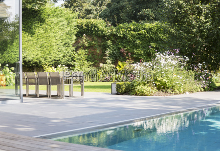 table and chairs by outdoor swimming