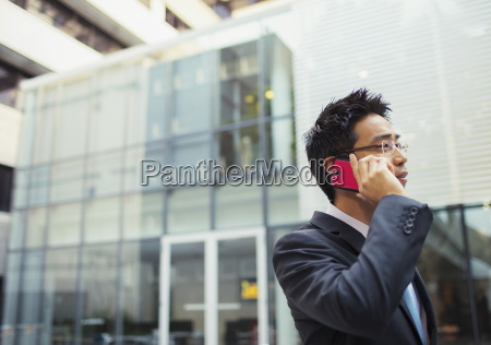 businessman talking on cell phone outside