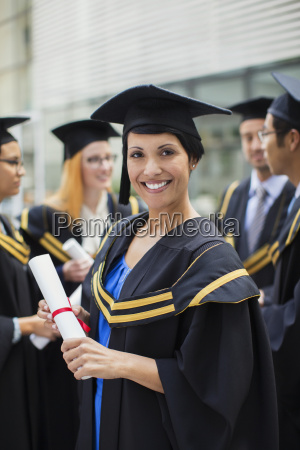 student in cap and gown standing