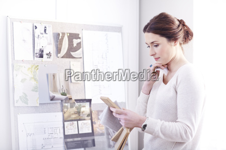 interior designer viewing swatches in office