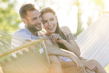affectionate young couple smiling in summer