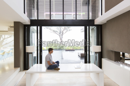 side view of man sitting on