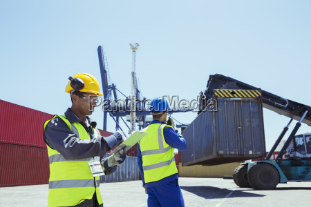 workers near cargo containers