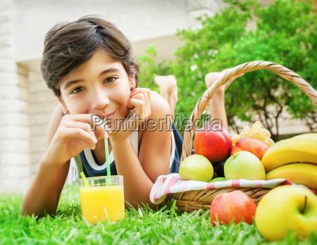 happy boy drinking juice