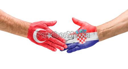 football teams handshake between turkey