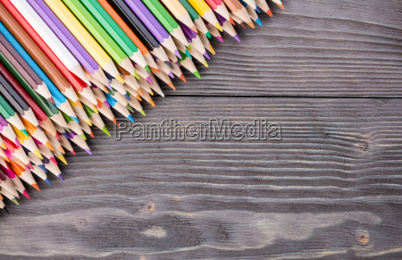 color pencils on gray wooden background