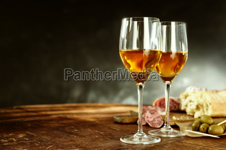 two glasses of sherry with tasty