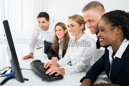 businesspeople looking at computer