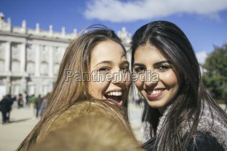 spain madrid two happy women taking