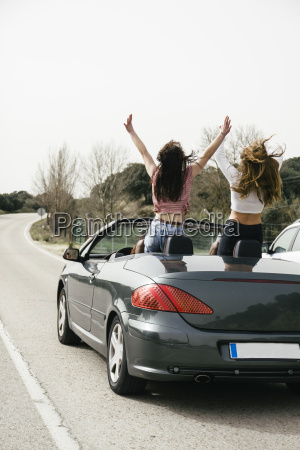 women having fun in a convertible
