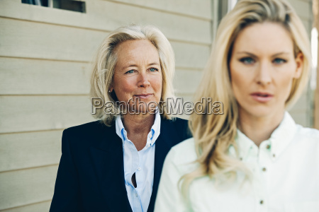 smiling mature woman looking at blond