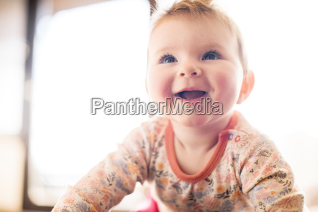 portrait of smiling baby girl looking