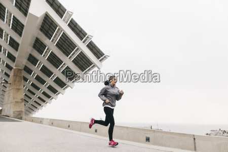 spain barcelona jogging woman solar plant