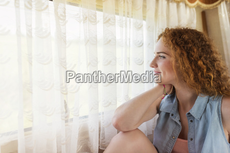 smiling young woman sitting in a