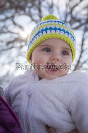 portrait of happy baby girl wearing