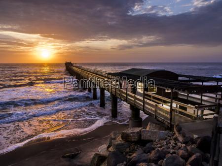 namibia swakopmund wooden boardwalk at sunset