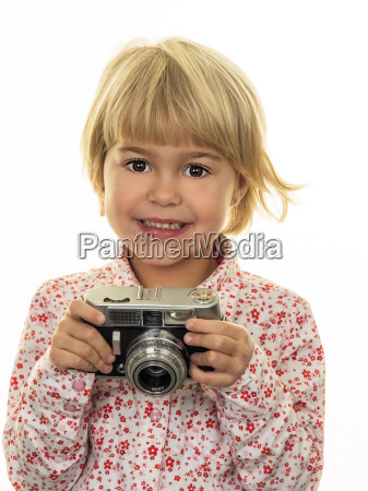 portrait of smiling girl holding old
